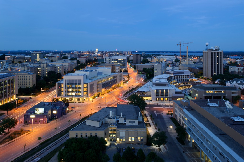 Nighttime falls over the Discovery Building, left of center; new Union South, right of center; and central University of Wisconsin-Madison campus. (Photo by Jeff Miller/UW Madison)